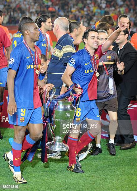 Barcelona´s midfielder Xavi and Cameroonian forward Samuel Eto'o celebrate with teammates after winning the Champions League Cup on May 27 2009 at...