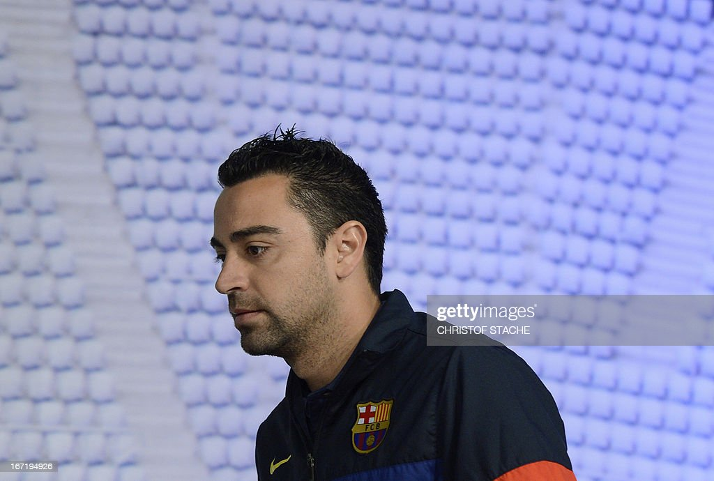Barcelona's midfielder Xavi Hernandez arrives for a press conference on the eve of the UEFA Champions League semi final first leg football match between FC Bayern Munich and FC Barcelona at the arena in Munich, southern Germany, on April 22, 2013. The semi final match will take place on April 23, 2013.