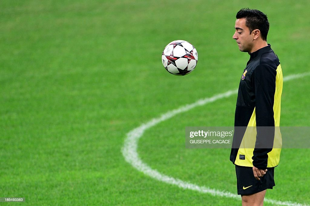 Barcelona's midfielder Xavi Hernandez attends a training session, on the eve of Champions League football match between AC Milan and FC Barcelona, on October 21, 2013 at the San Siro Stadium in Milan.