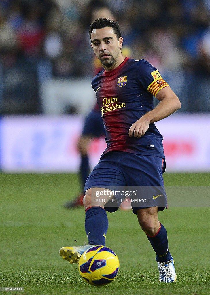 Barcelona's midfielder Xavi Hernandez kicks the ball during the Spanish league football match Malaga vs Barcelona at la Rosaleda stadium in Malaga on January 13, 2013.