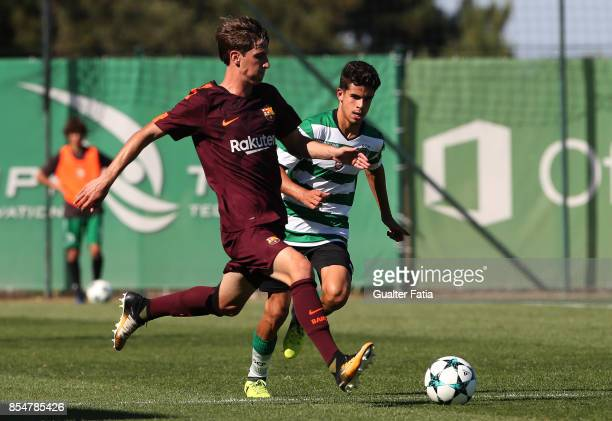 Barcelona's Miranda with Sporting CP Tomas Silva in action during the UEFA Youth League match between Sporting CP and FC Barcelona at CGD Stadium...