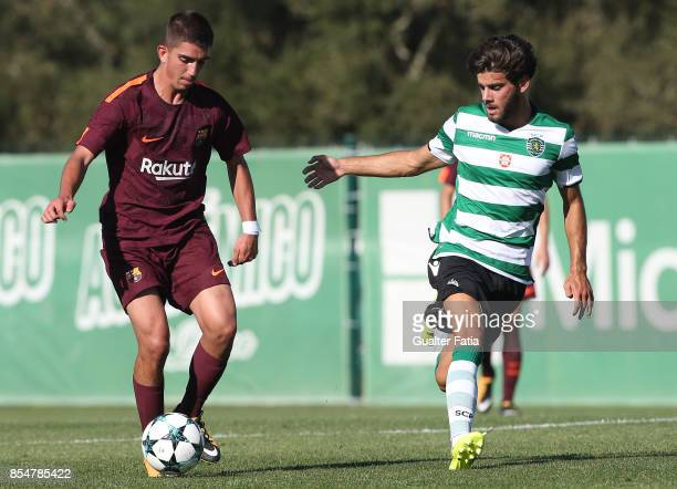 Barcelona's Monchu with Sporting CP Joao Oliveira in action during the UEFA Youth League match between Sporting CP and FC Barcelona at CGD Stadium...