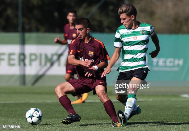 Barcelona's Monchu with Sporting CP Miguel Luis in action during the UEFA Youth League match between Sporting CP and FC Barcelona at CGD Stadium...