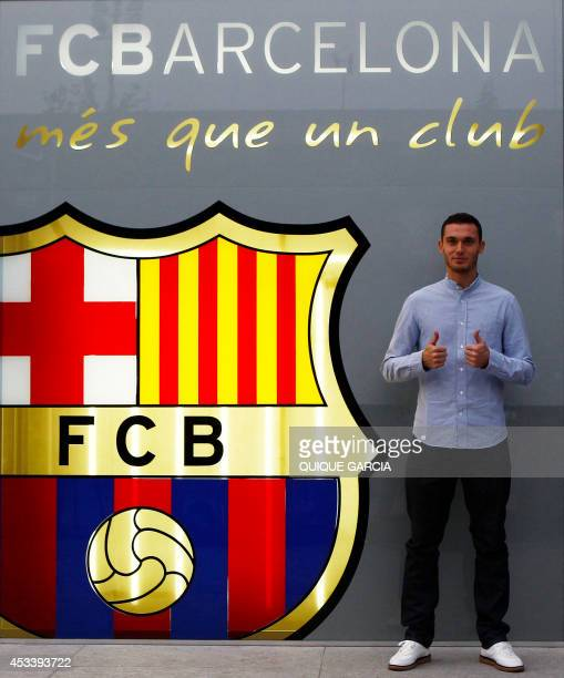 FC Barcelona's new Belgian defender Thomas Vermaelen poses outside the Camp Nou stadium in Barcelona on August 9 2014 Barcelona finally won the race...