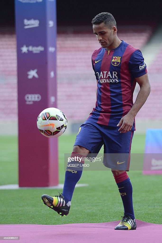 FC Barcelona's new Brazilian defender Douglas Pereira dos Santos controls the ball during his presentation at the Camp Nou stadium in Barcelona on August 29, 2014. La Liga giants Barcelona have completed the signing of Brazilian full back Douglas Pereira from Sau Paulo for an initial fee of four million euros (5.2 million USD), the club confirmed on August 27. AFP PHOTO / JOSEP LAGO