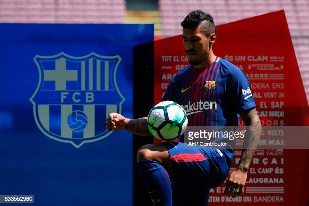 Barcelona's new Brazilian football player Paulinho Bezerra controls the ball during his official presentation after signing his new contract with the...