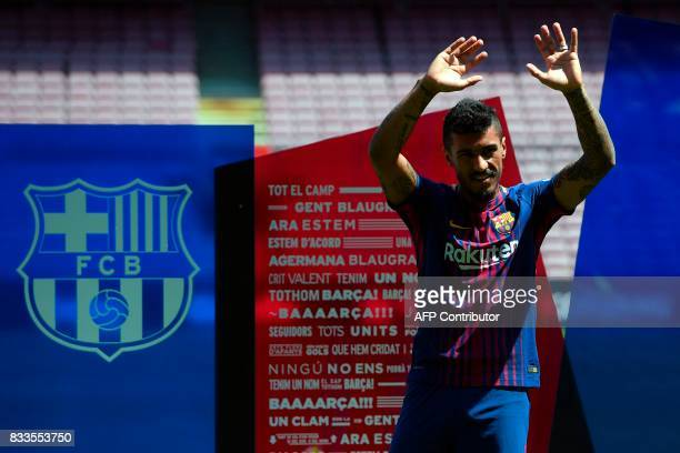 Barcelona's new Brazilian football player Paulinho Bezerra gestures during his official presentation after signing his new contract with the Catalan...