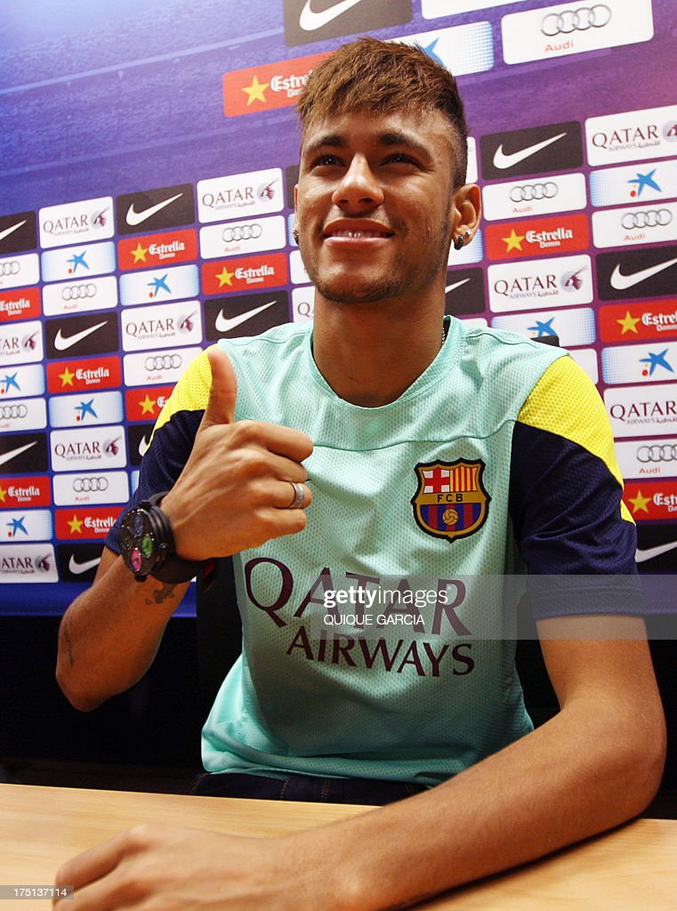 FC Barcelona's new Brazilian forward Neymar da Silva Santos Junior gives the thumbs up during a press conference at the Sports Center FC Bacelona Joan Gamper in Barcelona on August 1, 2013.