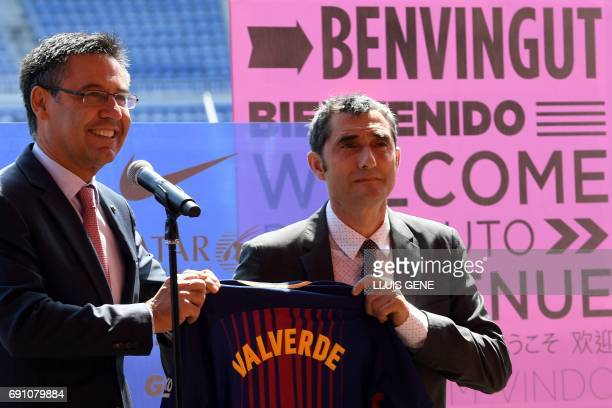 Barcelona's new coach Ernesto Valverde and Barcelona's president Josep Maria Bartomeu hold a jersey with Valverde's name on it during his official...