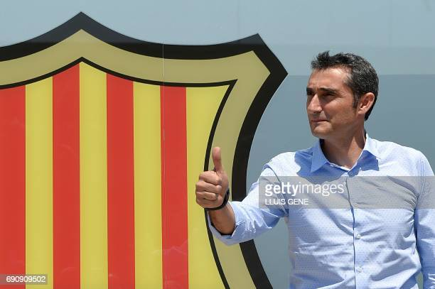 Barcelona's new coach Ernesto Valverde gives the thumbs up as he poses outside the Camp Nou stadium in Barcelona on May 31 2017 prior to signing his...