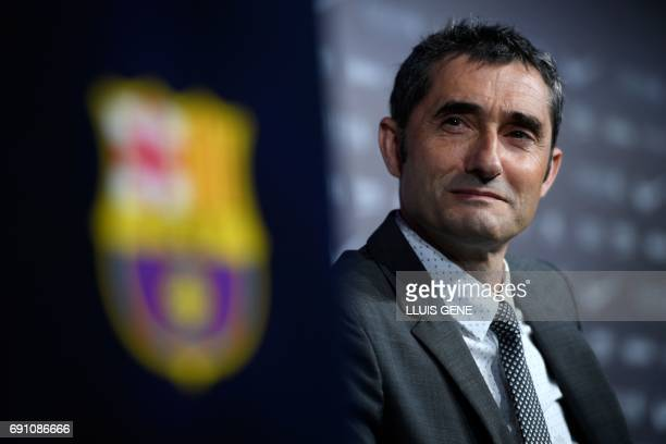 Barcelona's new coach Ernesto Valverde looks on as he gives a press conference during his official presentation in Barcelona on June 1 after signing...