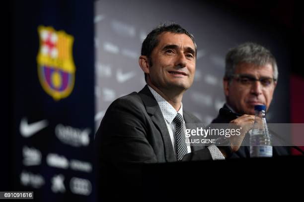 Barcelona's new coach Ernesto Valverde speaks during a press conference during his official presentation in Barcelona on June 1 after signing his new...