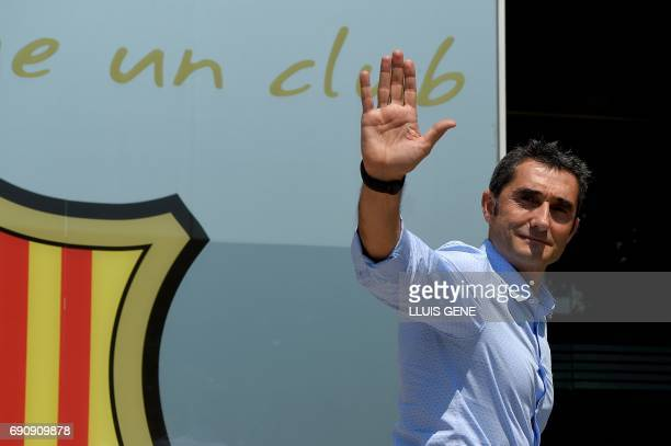 Barcelona's new coach Ernesto Valverde waves after posing outside the Camp Nou stadium in Barcelona on May 31 2017 prior to signing his new contract...