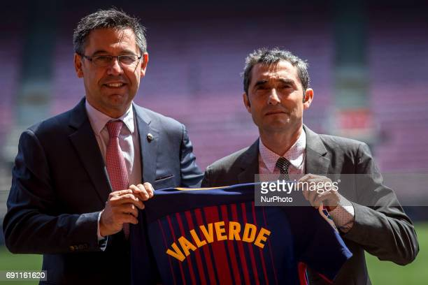 FC Barcelona's new head coach Ernesto Valverde poses for a photo with team's jersey during his presentation at Camp Nou stadium in Barcelona Spain on...