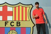 Barcelona's new player Andre Gomes gives the thumbs up as he poses outside the Camp Nou stadium in Barcelona prior to signing his new contract with...