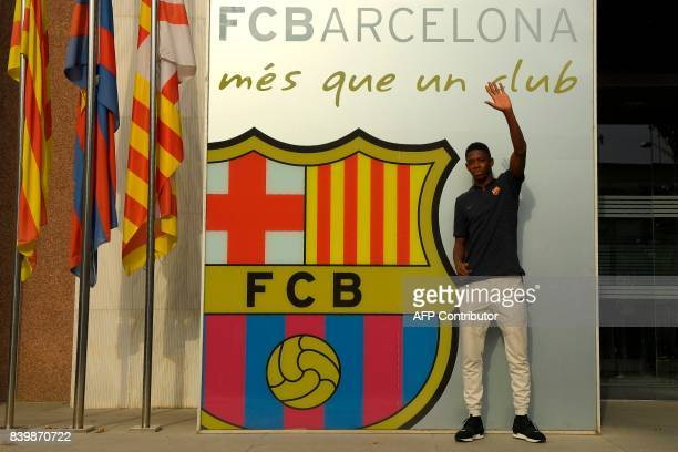 TOPSHOT Barcelona's new player French Ousmane Dembele poses outside the Camp Nou stadium in Barcelona prior to signing his new contract with the...
