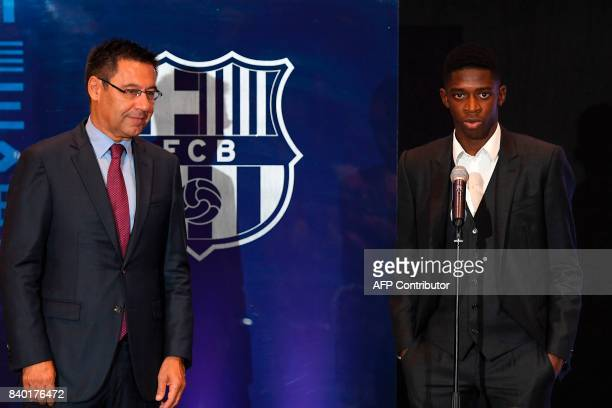 Barcelona's new player Ousmane Dembele delivers a speech next to Barcelona's president Josep Maria Bartomeu at the Camp Nou stadium in Barcelona...