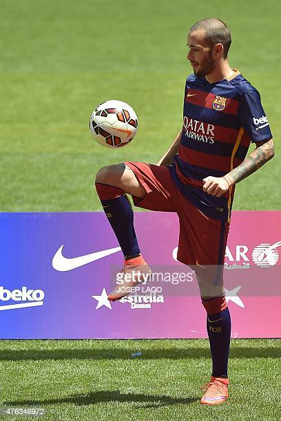 Barcelona's new Spanish defender Aleix Vidal does keepieup during his official presentation at the Camp Nou stadium in Barcelona on June 8 2015 AFP...