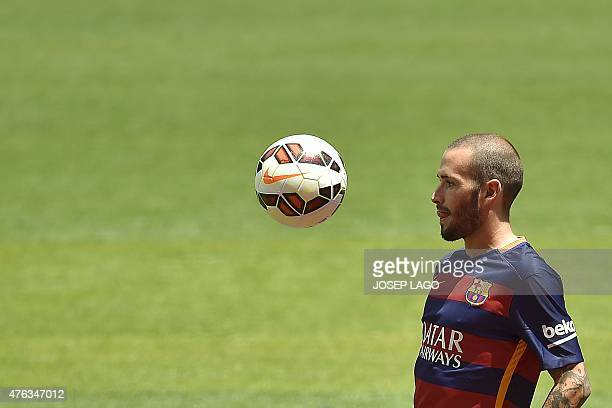 Barcelona's new Spanish defender Aleix Vidal eyes the ball during his official presentation at the Camp Nou stadium in Barcelona on June 8 2015 AFP...
