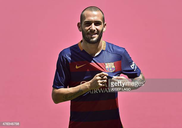 Barcelona's new Spanish defender Aleix Vidal poses with his new jersey during his official presentation at the Camp Nou stadium in Barcelona on June...