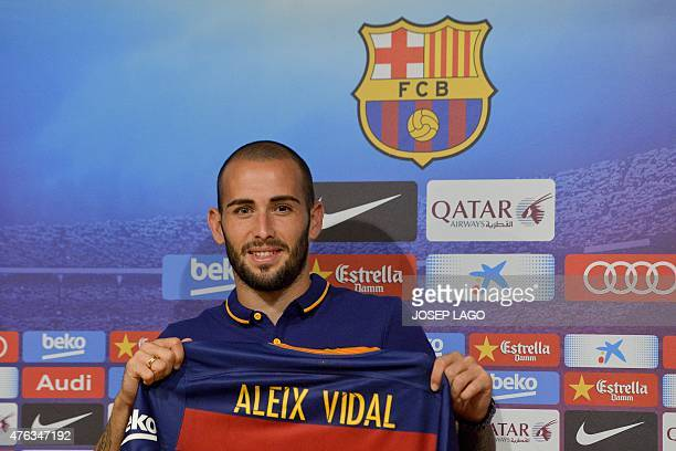 Barcelona's new Spanish defender Aleix Vidal poses with his new jersey prior to a press conference during his official presentation at the Camp Nou...