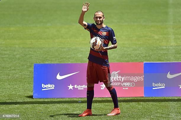 Barcelona's new Spanish defender Aleix Vidal waves during his official presentation at the Camp Nou stadium in Barcelona on June 8 2015 AFP PHOTO/...