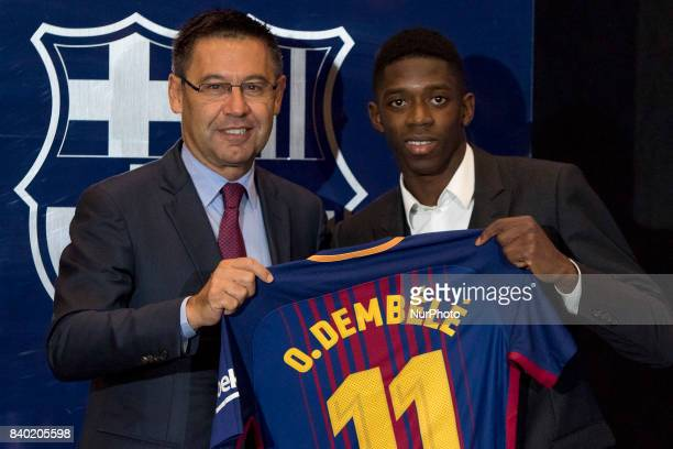 FC Barcelona's new transfer Ousmane Dembele and Charirman of FC Barcelona Josep Maria Bartomeu pose for a photo as they attend Dembele's presentation...