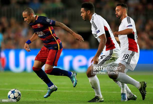 Barcelona's Neymar in action with Bayer Leverkusen's Jonathan Tah and Karim Bellarabi