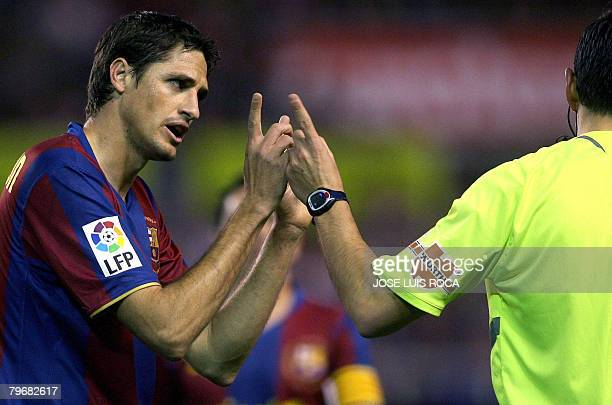 Barcelonas player Edmilson speaks with the referee during their Spanish League football match against Sevilla at Sanchez Pizjuan stadium in Seville...