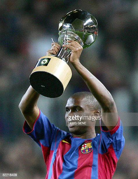Barcelona's player Samuel Eto'o of Cameroon shows his African Player of the Year 2004 award before Spanish League football match FC Barcelona versus...