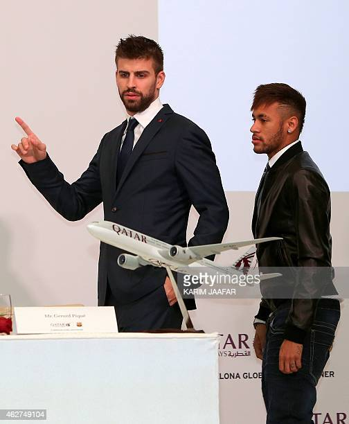 FC Barcelona's players Brazilian Neymar and Spanish Gerard Pique arrive for a press conference with pose with Qatar Airways' CEO to launch the latest...