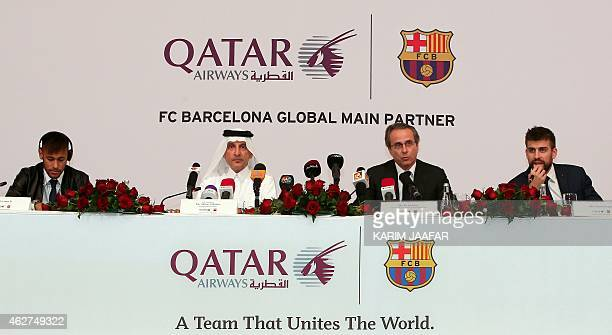 FC Barcelona's players Brazilian Neymar and Spanish Gerard Pique FC Barcelona's vicepresident Javier Faus and Qatar Airways' CEO Akbar alBaker give a...