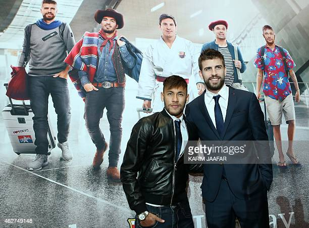 FC Barcelona's players Brazilian Neymar and Spanish Gerard Pique pose after a press conference with Qatar Airways' CEO to launch the latest marketing...