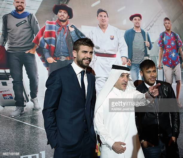 FC Barcelona's players Brazilian Neymar and Spanish Gerard Pique pose with the CEO of stateowned flag carrier Qatar Airways Akbar alBaker after a...
