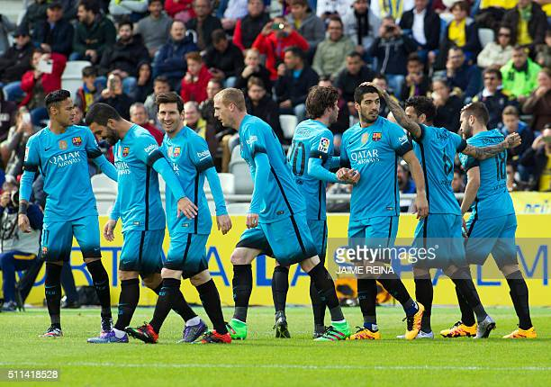 Barcelona's players celebrate a goal during the Spanish league football match UD Las Palmas vs FC Barcelona at the Gran Canaria stadium in Las Palmas...