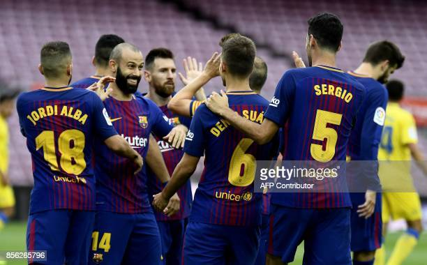 Barcelona's players celebrate a goal during the Spanish league football match FC Barcelona vs UD Las Palmas played behind closed doors at the Camp...