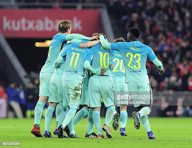Barcelona's players celebrate after Argentinian forward Lionel Messi scored his team's first goal during the Spanish Copa del Rey round of 16 first...
