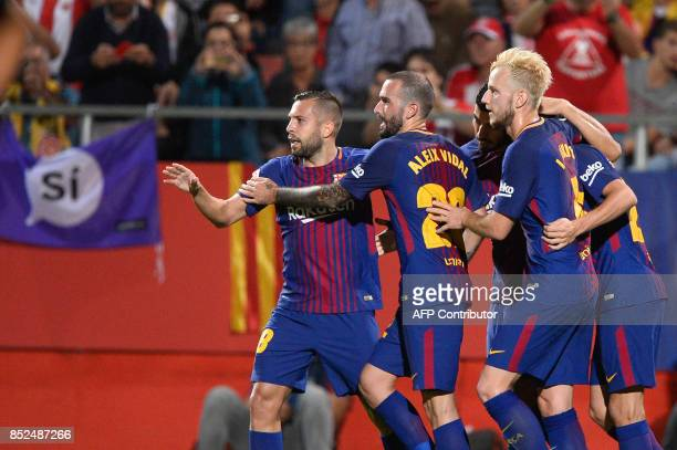 Barcelona's players celebrate after scoring during the Spanish league football match Girona FC vs FC Barcelona at the Montilivi stadium in Girona on...