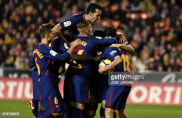 Barcelona's players celebrate after scoring during the Spanish league football match Valencia CF and FC Barcelona at Mestalla stadium in Valencia on...