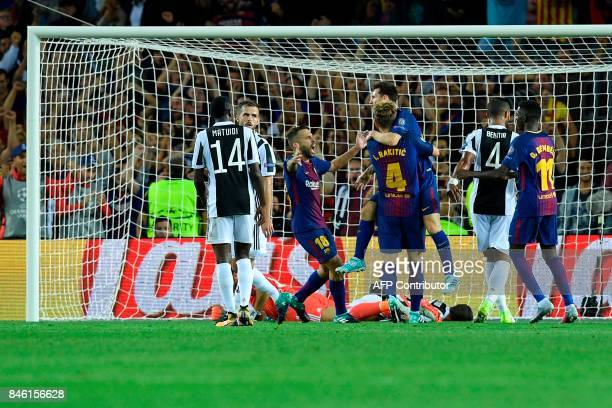 Barcelona's players celebrate after scoring their second goal during the UEFA Champions League Group D football match FC Barcelona vs Juventus at the...