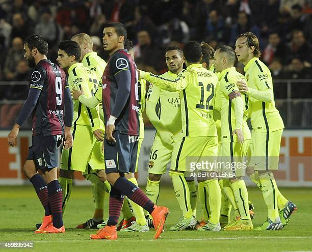 Barcelona's players celebrate after scoring their third goal during the Spanish Copa del Rey round of 32 first leg football match SAD Huesca vs FC...