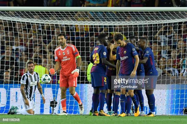 Barcelona's players celebrate after scroing their second goal during the UEFA Champions League Group D football match FC Barcelona vs Juventus at the...