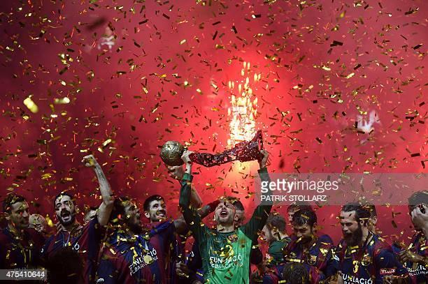 Barcelona´s players celebrate after the Handball Champions League EHF Final Four Final match FC Barcelona vs MKBMVM Veszprem in Cologne western...