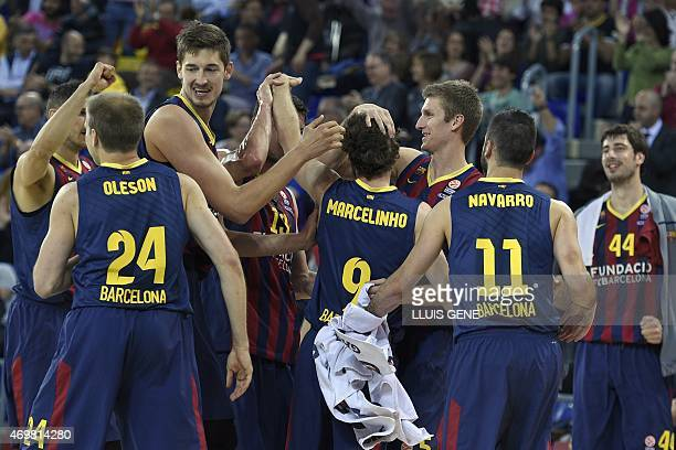 Barcelona's players celebrate during the Euroleague playoff basketball match FC Barcelona vs Olympiacos Piraeus at the Palau Blaugrana in Barcelona...