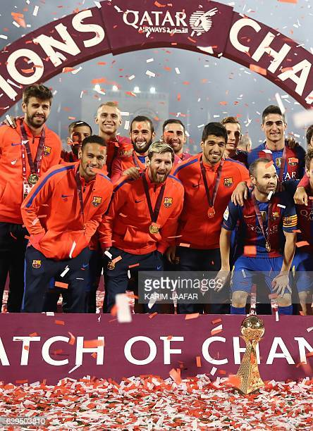 FC Barcelona's players celebrate following a friendly football match between FC Barcelona and Saudi Arabia's AlAhli FC on December 13 2016 in the...
