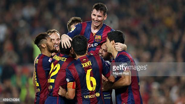 Barcelona's players celebrate Lionel Messi's second goal during the La Liga match between FC Barcelona and Sevilla FC at Camp Nou on November 22 2014...