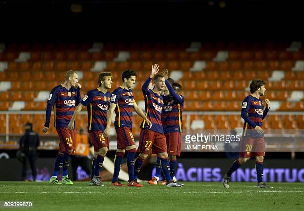 Barcelona's players celebrate qualifying for the final during the Spanish Copa del Rey football match Valencia CF vs FC Barcelona at Mestalla stadium...