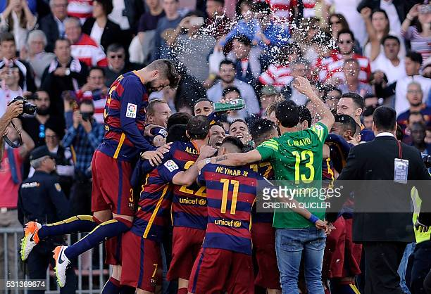 Barcelona's players celebrate their 24th La Liga title at the end of the Spanish league football match Granada CF vs FC Barcelona at Nuevo Los...
