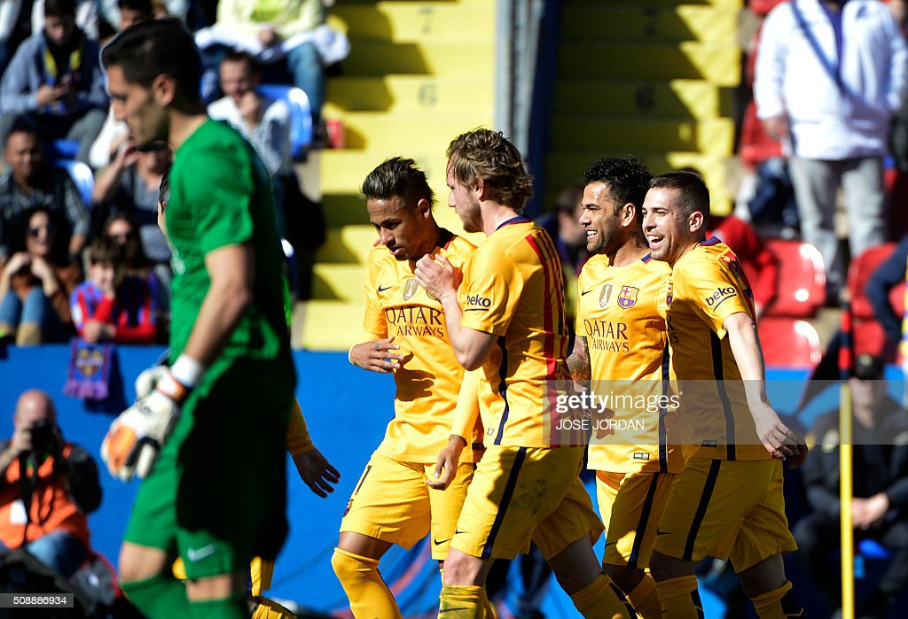 Barcelona's players celebrate their first goal during the Spanish league football match Levante UD vs FC Barcelona at the Ciutat de Valencia stadium in Valencia on February 7, 2016. AFP PHOTO / JOSE JORDAN / AFP / JOSE JORDAN