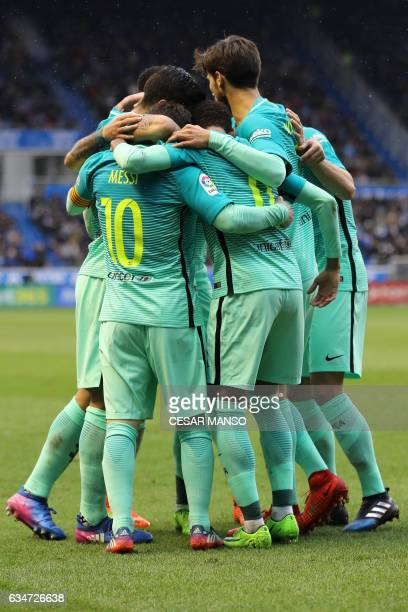 Barcelona's players celebrate their team's goal during the Spanish league football match Deportivo Alaves vs FC Barcelona at the Mendizorroza stadium...